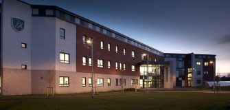 Bede Academy by night